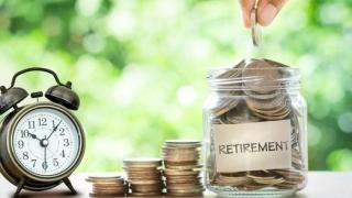 Retirement-savings-jar-full-of-coins-and-alarm-clock_large
