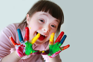 Child with painted hands